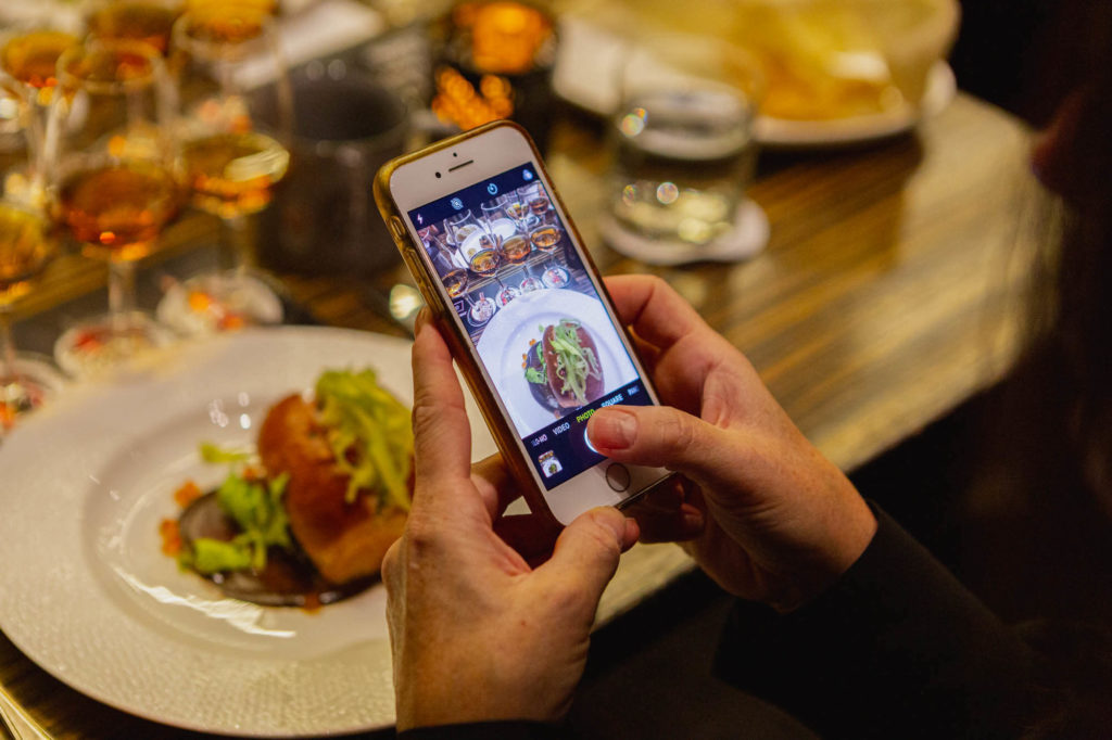 Guest taking photo of lobster roll