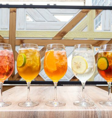 Summer Spritz glasses lined up on the patio at Jump Restaurant in Toronto