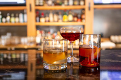 A negroni, old fashioned and manhattan standing side by side on Bannock's Bar