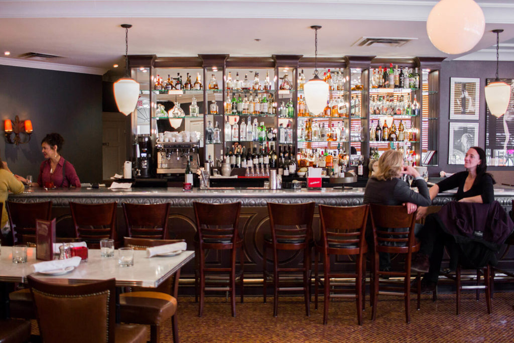 Image of the bar at Biff's Bistro with two guests sitting at the bar