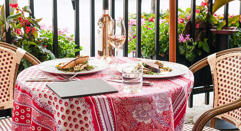Image of rosé and dinner on Biff's Bistro's patio