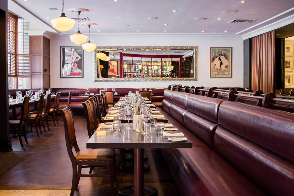Image of tables and chairs in the main dining room at Biff's Bistro