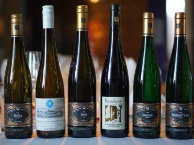 Six wine bottles in a row at Luma Restaurant