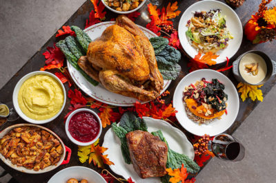 A table spread for Thanksgiving with turkey and all the fixings.