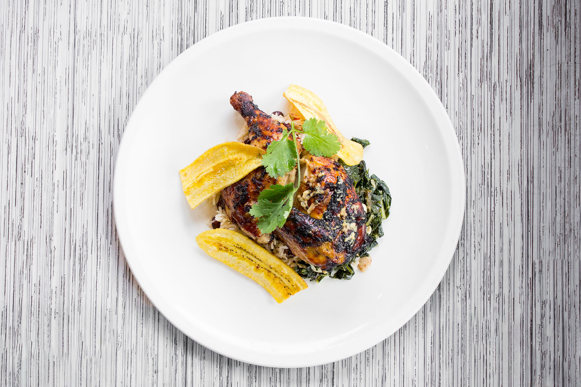 Winterlicious jerk chicken at Canteen on white plate