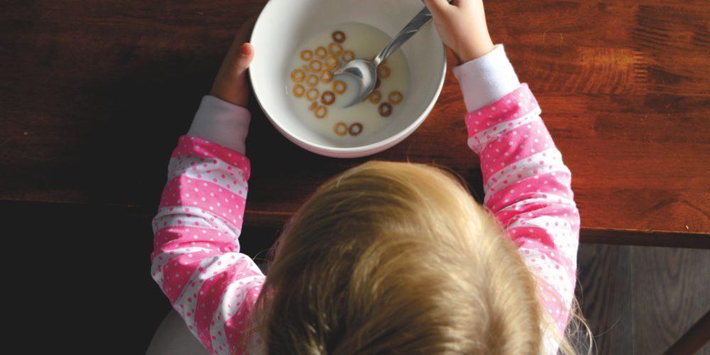 Child eating cereal in honour of Canoe childhood nostalgia tasting menu