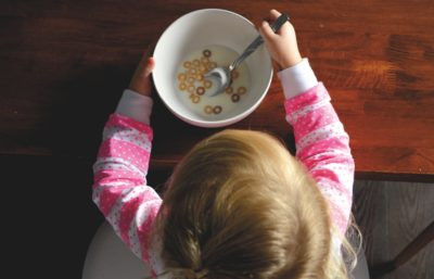 Child eating cereal in honour of Canoe childhood nostalgia tasting menu
