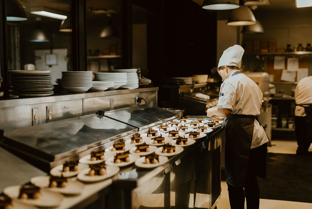 Chef plating desserts for a wedding reception at Canoe.