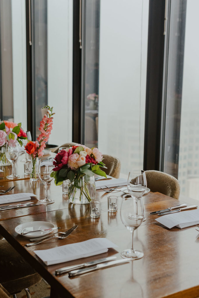 Bright floral tablescape set for a wedding in the Canoe dining room downtown Toronto.