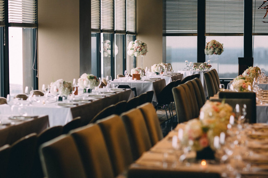 Florals and tables set for a wedding reception at Canoe, in the heart of downtown Toronto.