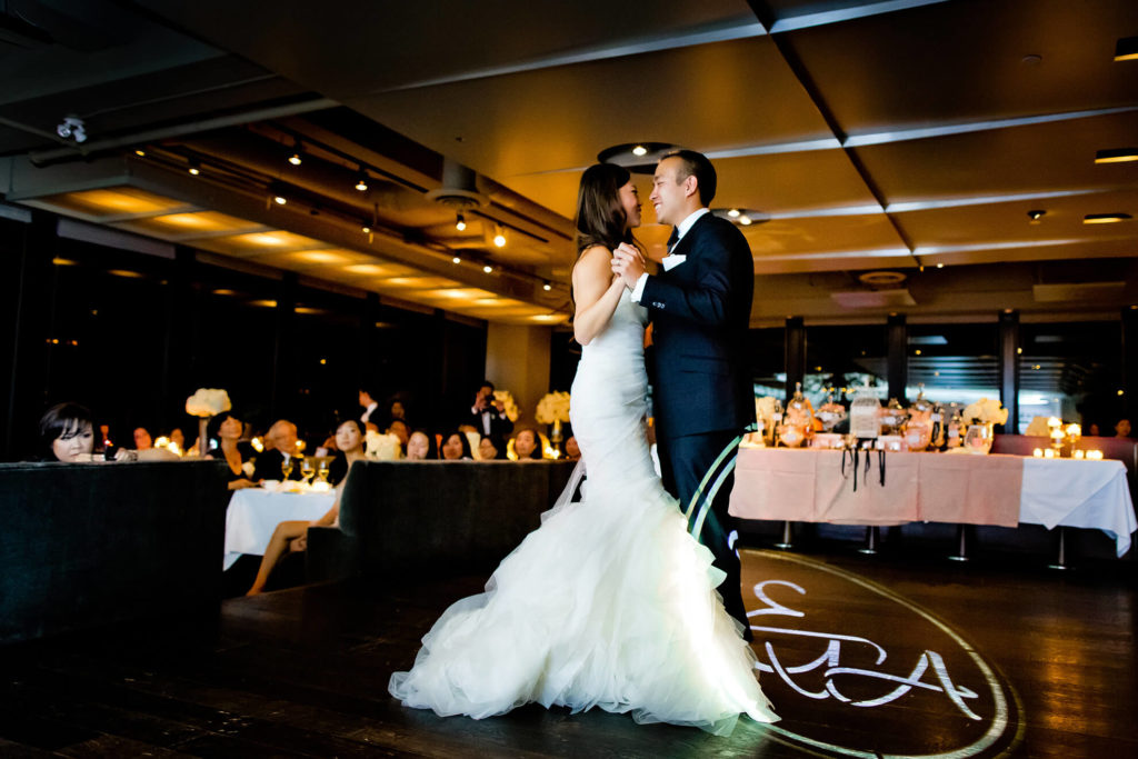 Bride and groom during their first dance at Canoe restaurant downtown Toronto.