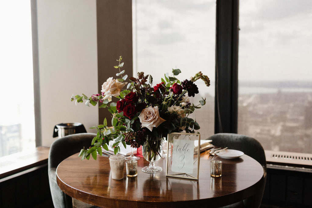 Floral arrangement on the head table at a wedding reception at Canoe.