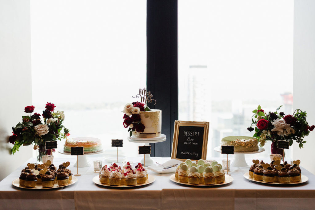 Dessert table against the window at a wedding reception in the Canoe dining room.