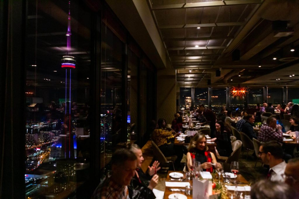 Busy dining room with CN tower view