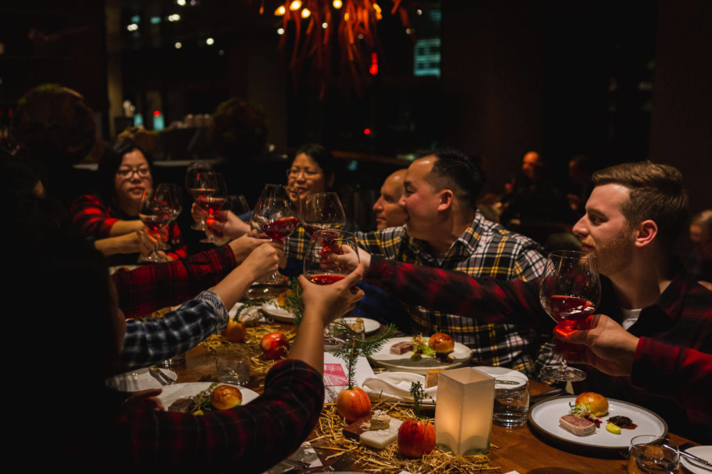 friends cheering wine glasses