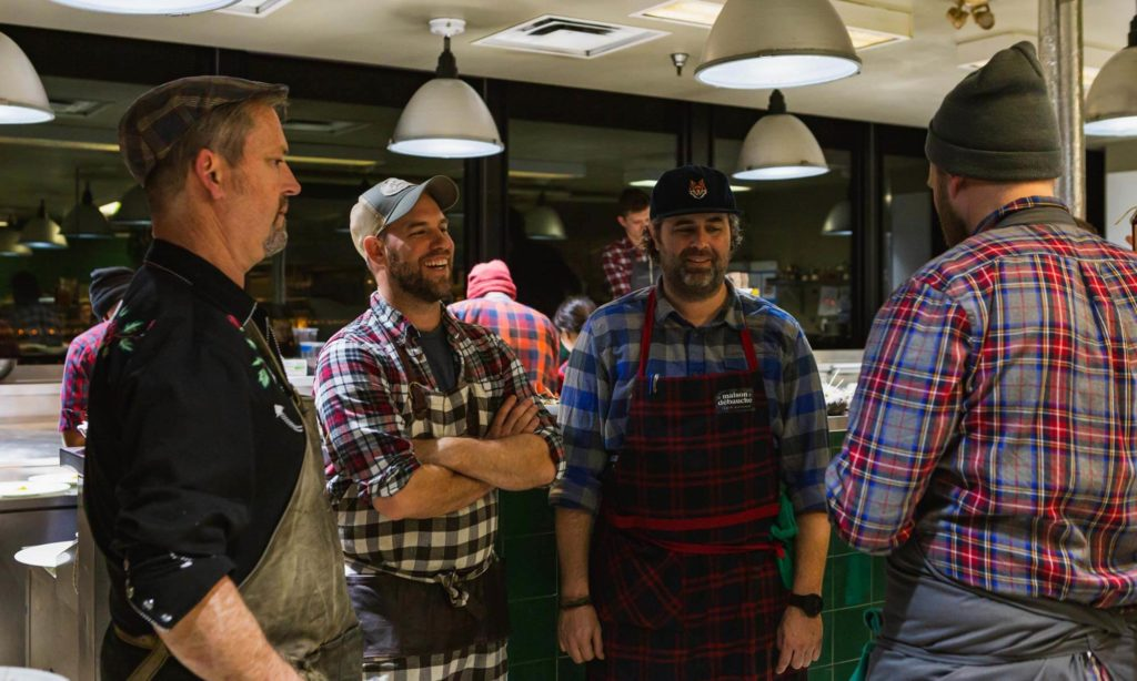 Chefs laughing in the kitchen