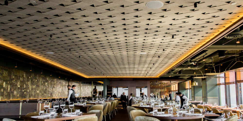 Canoe interior with woven ceilings and servers cleaning tables