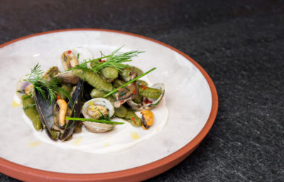 Salad on white and terracotta plate