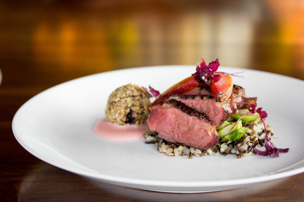 Smoked duck breast on a wheatberry risotto.