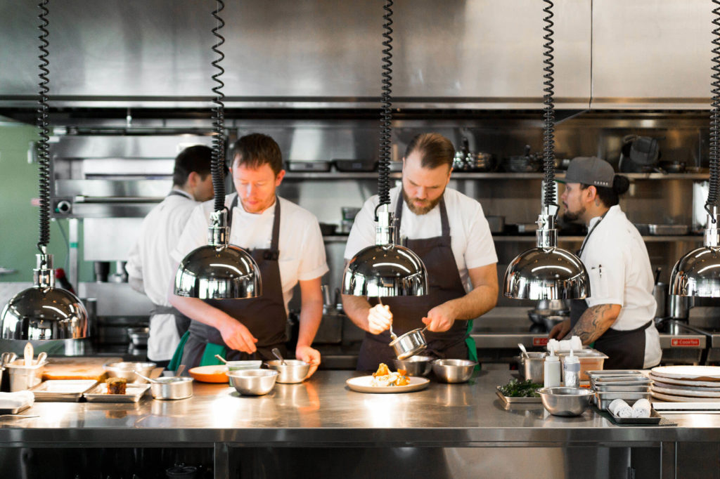 Chefs working on the line in the Canoe kitchen.