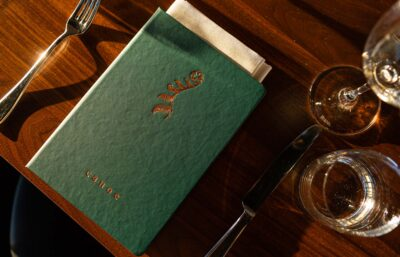 Canoe menu on table with glasses and cutlery around it
