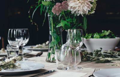 Easter table setting with a bouquet of flowers