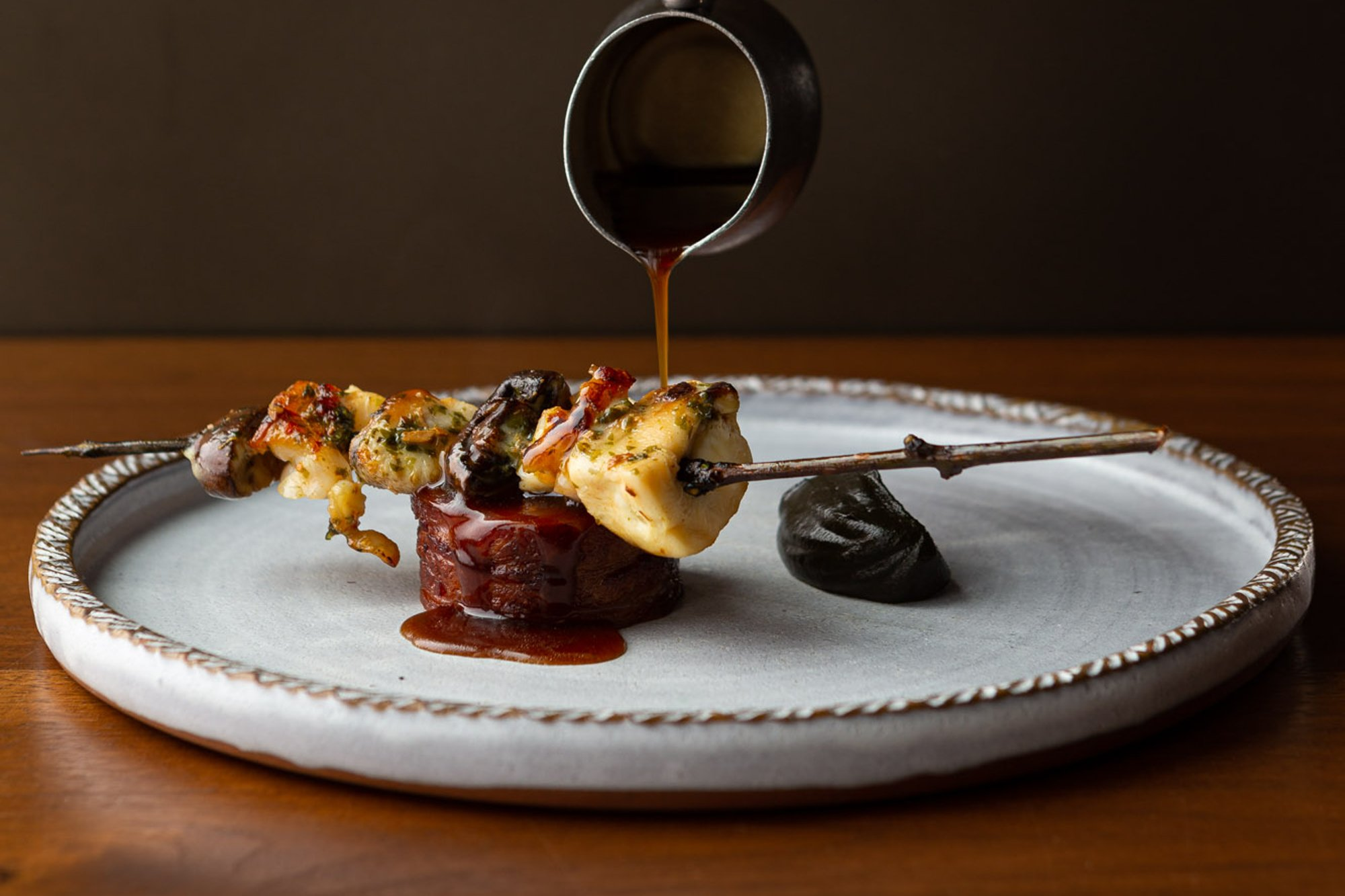 Canoe Restaurant tasting menu dish - surf and turf with jus pour