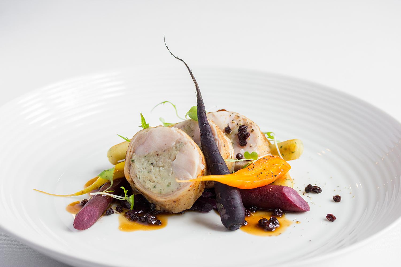 Taste Alsace Saddle of Rabbit Main on White Plate at Auberge du Pommier