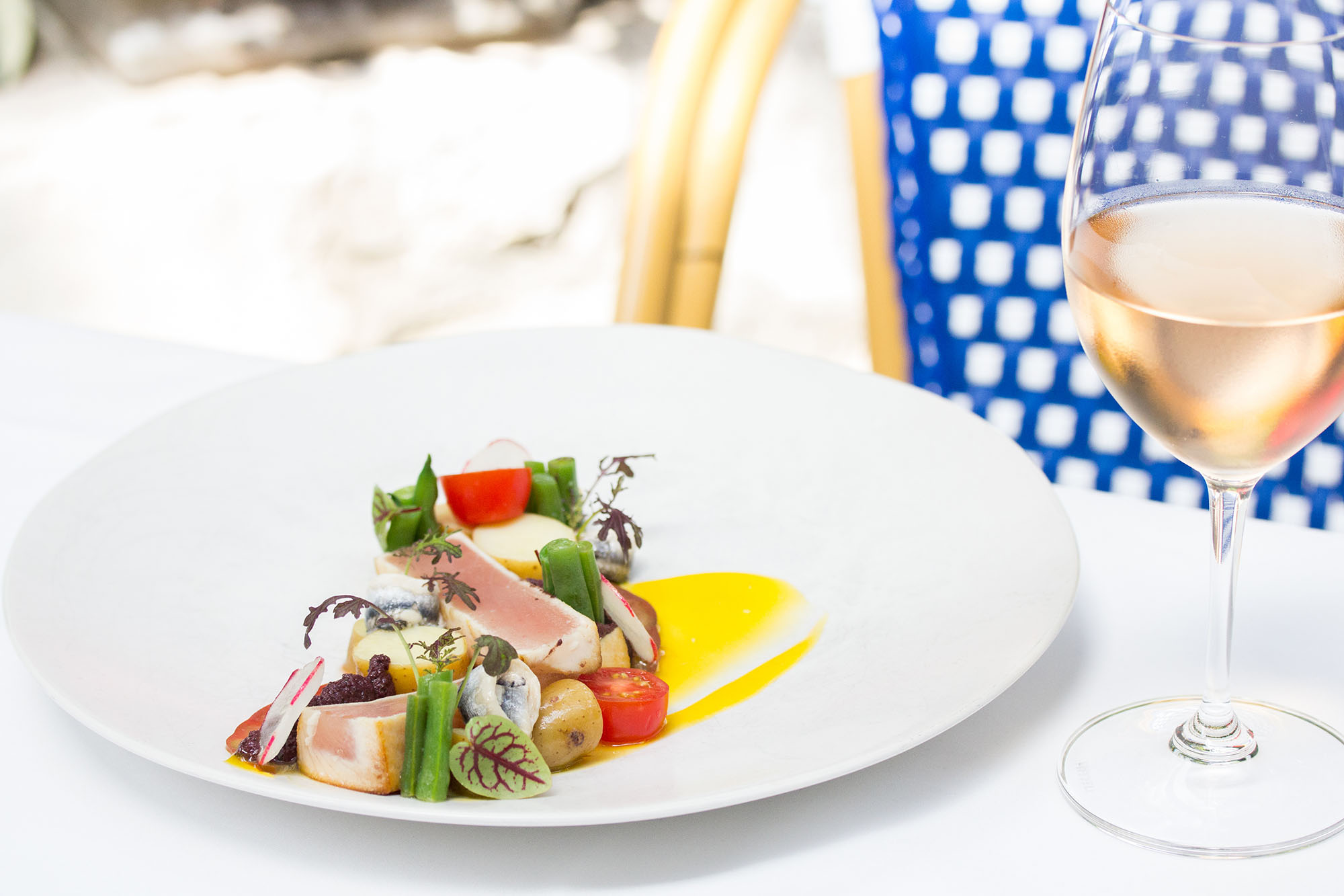 Summerlicious dishes on white table at Auberge du Pommier restaurant in North York