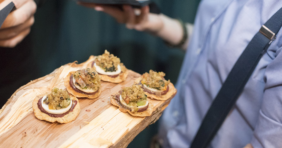 Passed canapes on a wooden serving tray