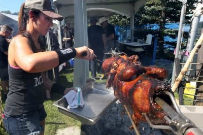 calgary-charbar-chef-connie-desousa-cuts-from-a-roast-pig-at