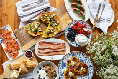 Mushroom quiche, bacon, fruit, and sides from Mother's Day brunch kit