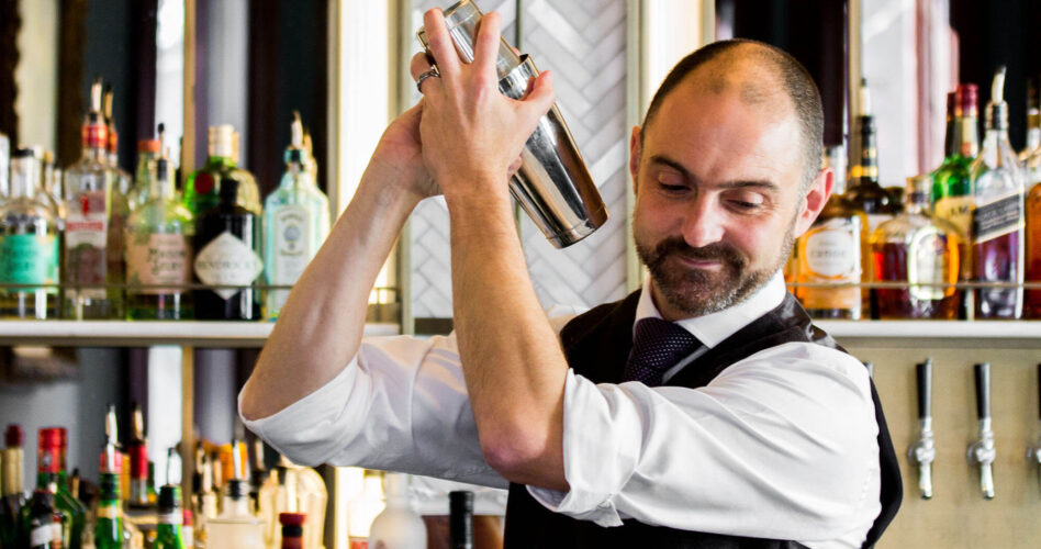 Bartender shaking a martini