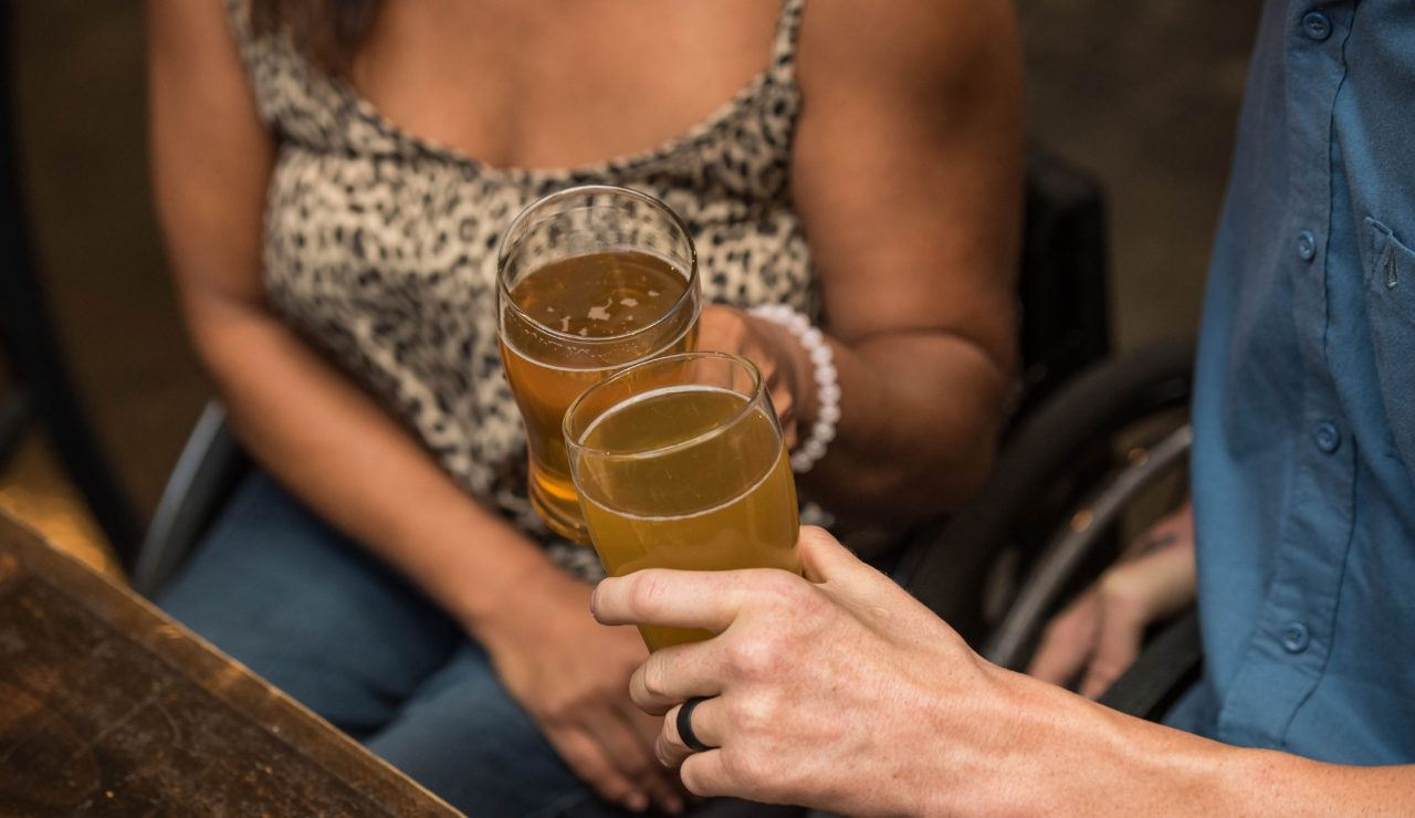 Man and woman toasting with beer glasses