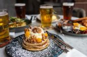 Table of brunch items and glasses of beer at Liberty Commons at Big Rock Brewery