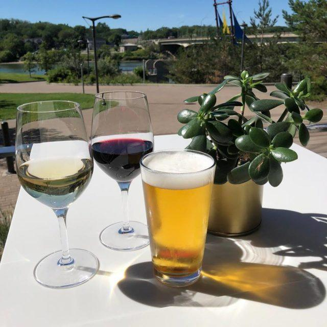Glass of white wine, glass of red wine and pint of beer on the patio