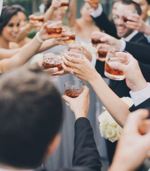 Wedding guests toasting with drinks