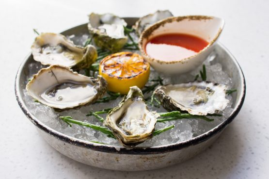 Buck-a-Shuck Oysters at Beaumont Kitchen in Toronto