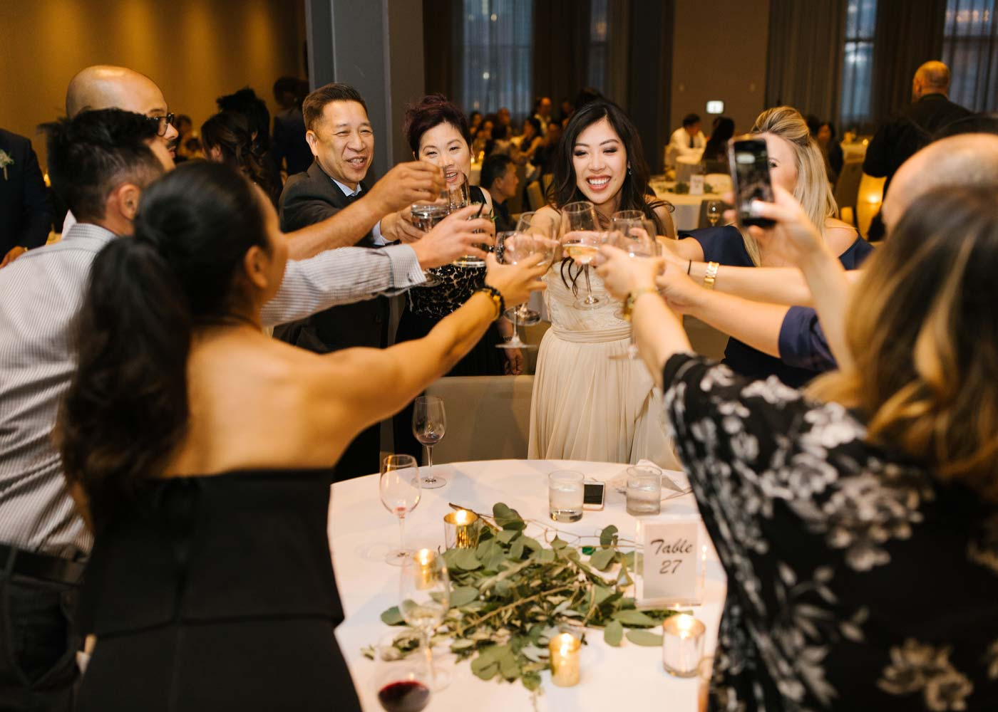 Wedding guests cheersing at Hudson event venue in Calgary