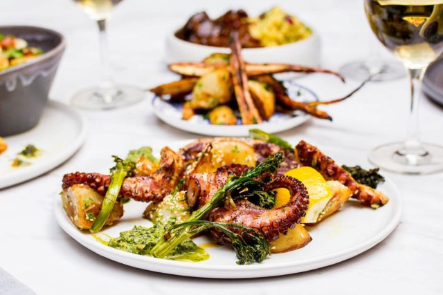 grilled octopus, sesame garlic potatoes, green harissa, spinach