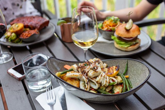 O&B Blue Mountain patio table with entrees and wine