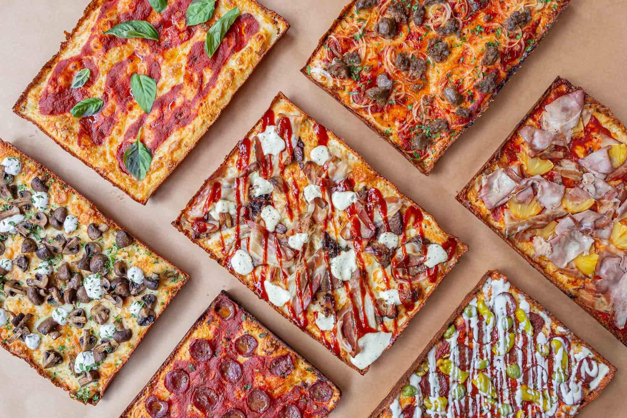 Flatlay of Detroit-style pizzas