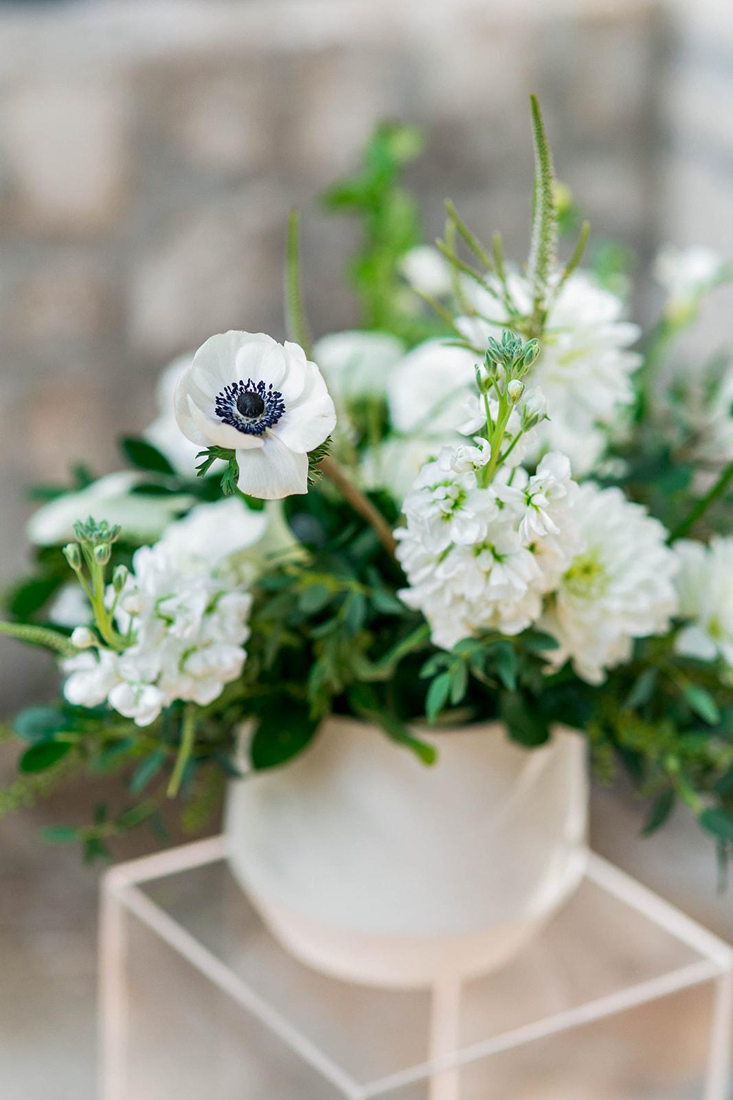 Flower arrangement at an intimate outdoor wedding at Auberge du Pommier in Toronto
