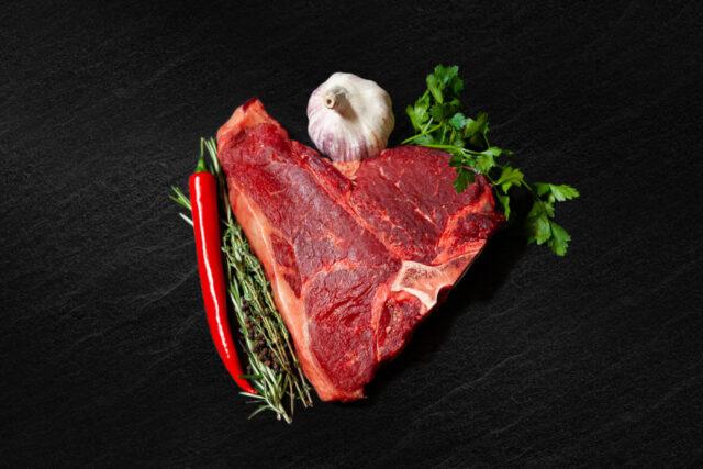 Porterhouse steak from Cleaver Meat Co. on a black backdrop