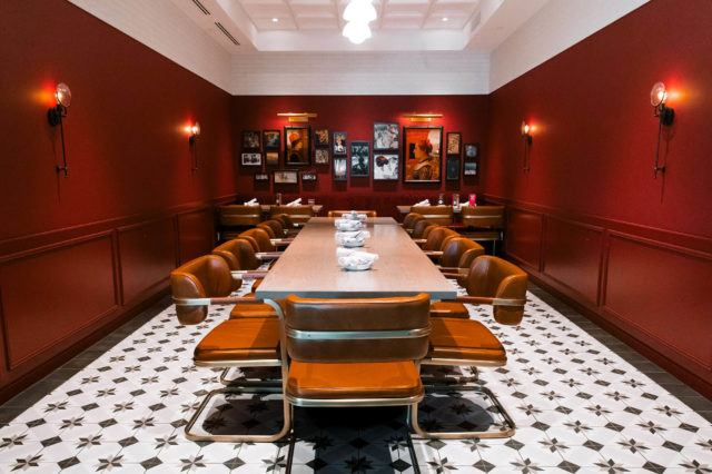 Large table in private dining room at Buffo set for a dinner event