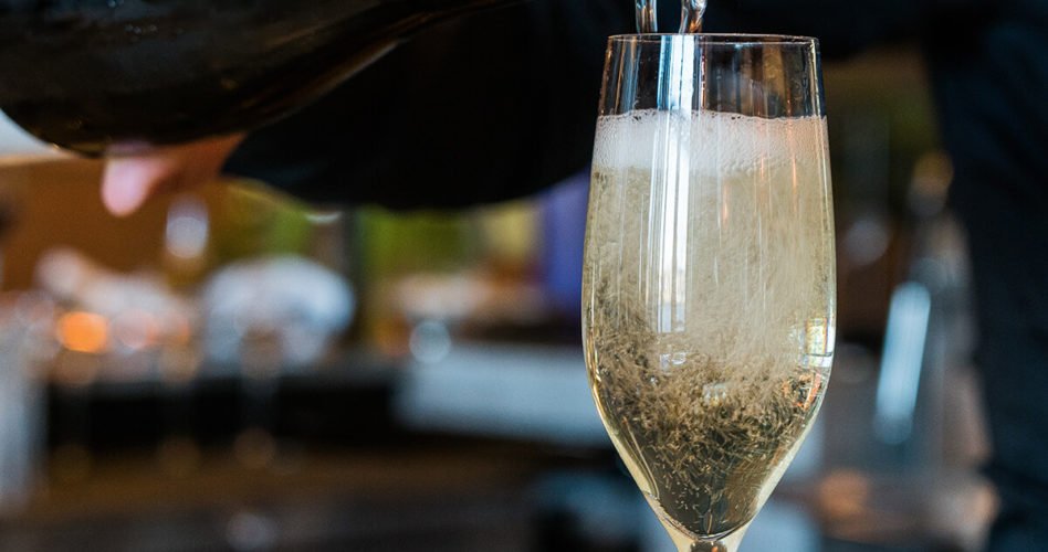 Pouring glass of sparkling wine
