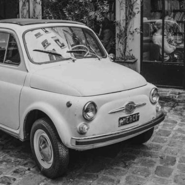 Small White Vintage European Car