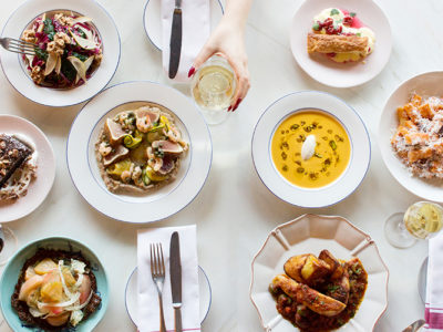 Parcheggio tablescape of entrées, appetizers, and wine for Winterlicious