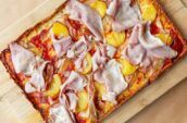 Detroit-style pizza topped with ham and pineapple at Beauty Eats in Toronto