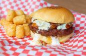 Burger and tater tots at Beauty Eats in Toronto